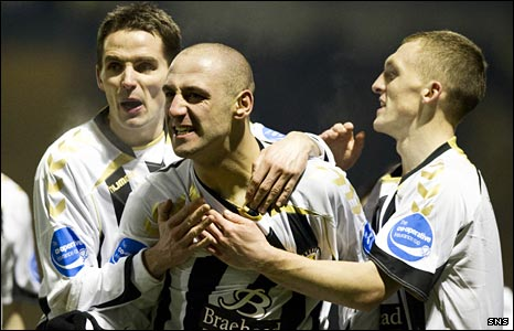 Billy Mehmet (centre) celebrates his goal