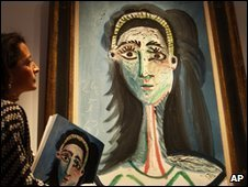 "A Christie""s employee looks at a 1963 painting entitled ""Tete de femme (Jacqueline)"" by Pablo Picasso on display at the auction house in London"