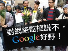 Chinese people holding a  banner wishing Google well