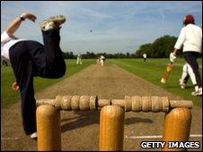 Eton pupils playing cricket on Eton College fields