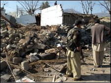 Pakistani officials at the blast site in Lower Dir, Pakistan, 3 Feb 2010