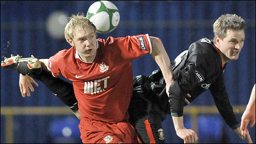 Ross Redman of Portadown in action against Glentoran defender Colin Nixon