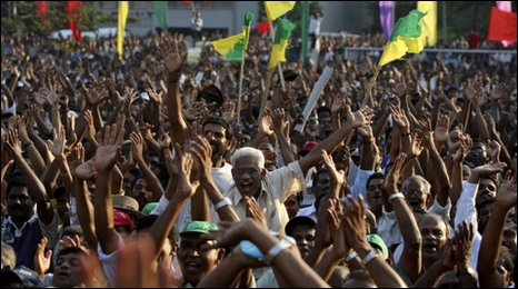 Opposition supporters shout slogans in a park during a protest in Colombo, Sri Lanka, Wednesday, Feb. 3, 2010