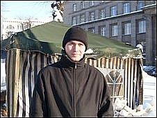 Protester Yevgenijs Karelins in front of tent