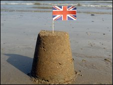 Sandcastle with Union Jack flag on top