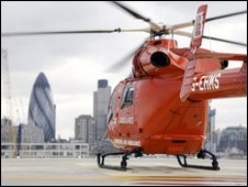 Air ambulance with the Gherkin in background