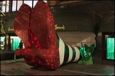 Harrods window display with Wicked Witch of the East's ruby slippers