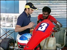 Armaan Ebrahim and mechanic discuss his kart