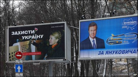 Billboards of Yulia Tymoshenko with the words 'Defend Ukraine', left, and Viktor Yanukovych with the words 'For Yanukovych in Kiev, Ukraine, 3 February 2010