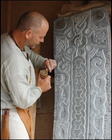 The skilled art of stone carving at a Viking Festival reenactment in Peel on the Isle of Man