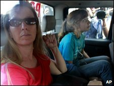Missionaries Corinna Lankford, left, and her daughter Nicole Lankford, 18, both of Middleton, Idaho, being taken back to jail after being charged in Haiti - 4 February 2010