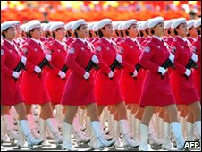 Chinese women march past Tiananmen Square to celebrate 60 years of communist rule (file images from 1/10/10)