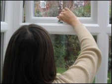 A woman opening a window