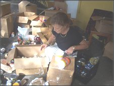 Volunteer Debbie Benik gathers supplies at a Haitian Catholic church in Miami