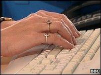 Office worker typing on keyboard