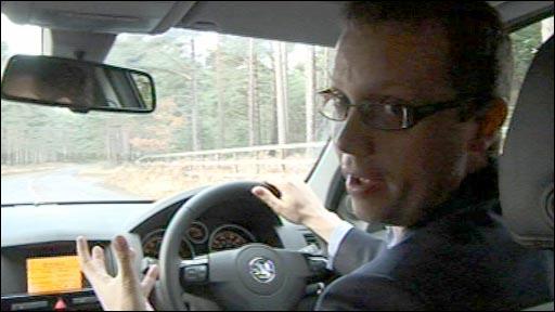 Richard Scott driving a car
