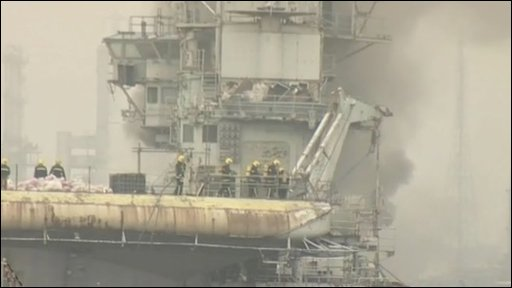 Fire crews on board the Clemenceau