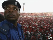 Sierra Leoneon policeman in front of a rally