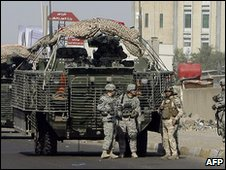 US army troops patrol the streets of Baghdad on February 4, 2010