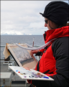 Rowan Huntley painting on board Royal Navy survey ship HMS Scott(Photo: Leading Photographer Williams, Royal Navy)