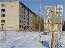 Deserted buildings and a sign in Skrunda-1. Photo: 5 February 2010