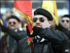 Man in black beret and dark glasses