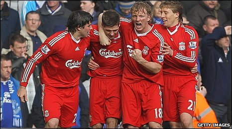 Liverpool striker Dirk Kuyt, second from the right, celebrates