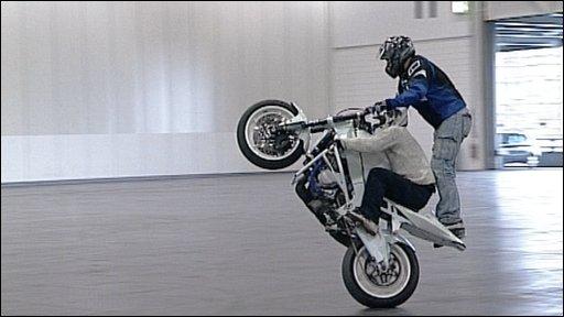 Two men on a motorbike
