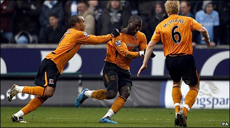 Jozy Altidore celebrates after scoring his first Premier League goal for Hull