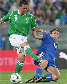 Northern Ireland's David Healy in action against Italy's Riccardo Montolivo