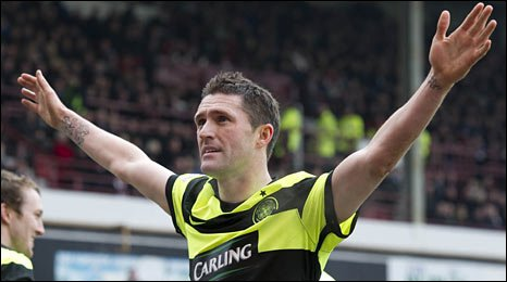 Robbie Keane celebrates his first goal for Celtic from the penalty spot