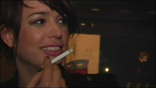 A lady holding a cigarette