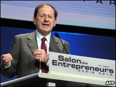 Herve Novelli, junior minister for trade, crafts, SMEs, tourism and services speaks during the opening session at the Salon des Entrepreneurs in Paris, 3 February 2010