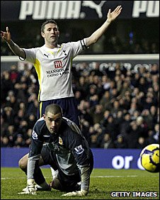Tottenham striker Robbie Keane has a shot saved by Hull keeper Boaz Myhill