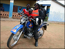 Riders for Health team member Violet Ng'ambi and her motorbike at Bwanunkha rural health centre