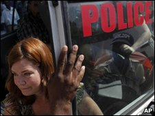 Laura Silsby leaves a police car in Port-au-Prince on 8 February 2010