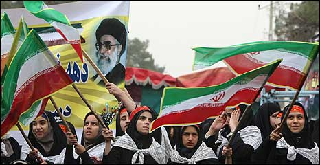 Schoolgirls in Tehran wave Iranian flags