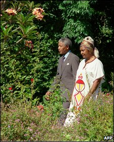 Freed anti-apartheid leader and African National Congress (ANC) member Nelson Mandela (L) and his then wife Winnie in the garden of Archbishop Desmond Tutu's residence in Cape Town, one day after his release from jail