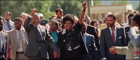 Nelson Mandela (C) and his then wife Winnie raising their fists and saluting cheering crowd upon Mandela's release from the Victor Verster prison near Paarl