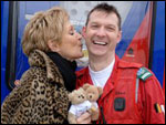 Judi plants a kiss on one of the Air Ambulance crew