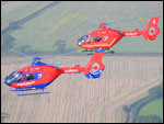 Two of the Air Ambulance helicopters flying over the region