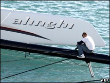 A crew member works on the Alinghi boat