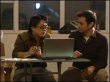 Zhu Meng (left) speaks to Damian Grammaticas in Urumqi