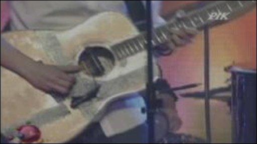 Man playing accoustic guitar