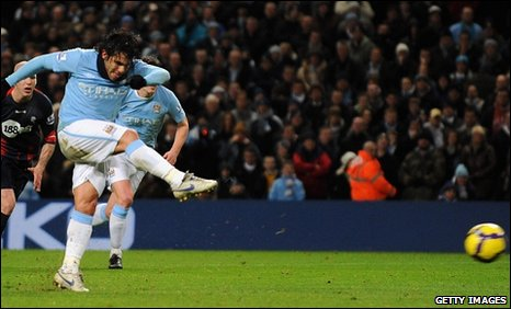 Carlos Tevez scores from the penalty spot