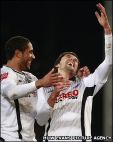 Ashley Williams celebrates Swansea's win with Fede Bessone