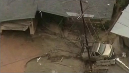 A home damaged by mudslides