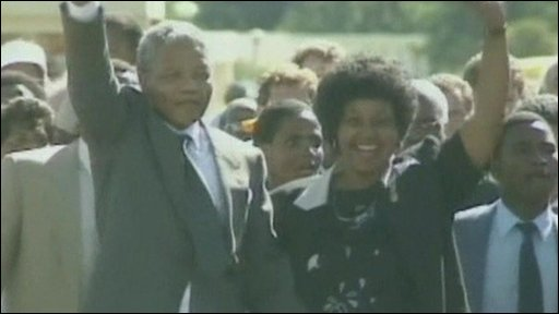 Nelson Mandela and his then wife Winnie raise fists upon his release