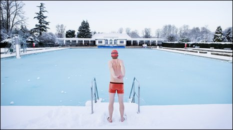Swimmer at icy outdoor pool