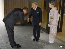 US President Barack Obama bows and shakes Emperor Akihito's hand simultaneously while visiting Japan - 14 November 2009